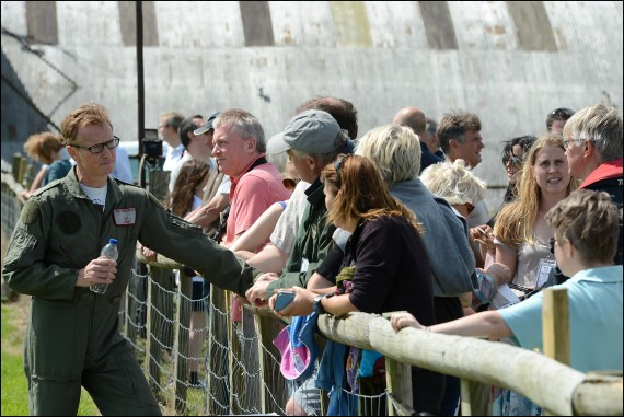 Flt Lt. Anthony 'Parky' Parkinson talks Spitfire with the crowds